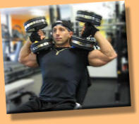 Eric lifting dumbbells
